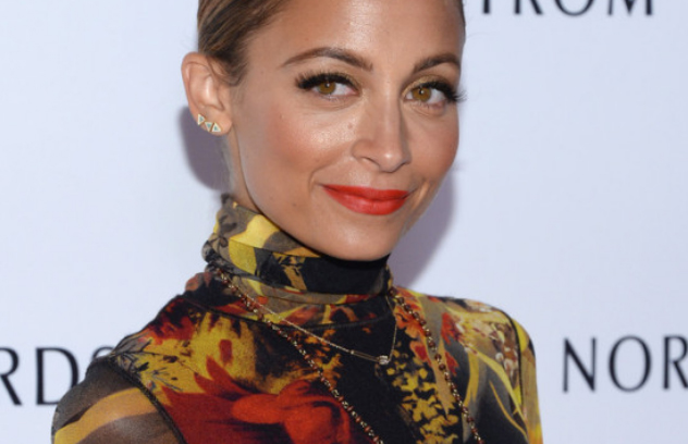Nicole Richie wears leopard print flats with her Jean Paul Gaultier Winter Garden-Print Turtleneck Maxi Dress