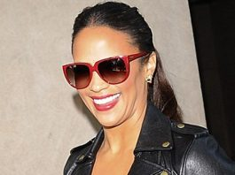 Paula Patton red rimmed sunglasses black biker jacket leopard print dress