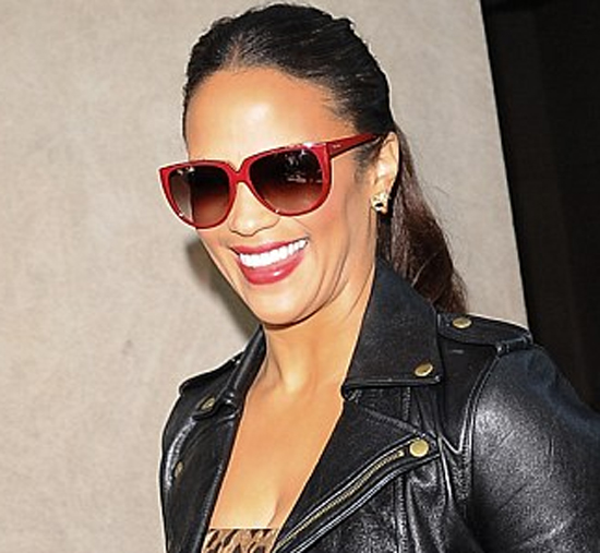 Paula Patton red rimmed sunglasses black biker jacket leopard print dress