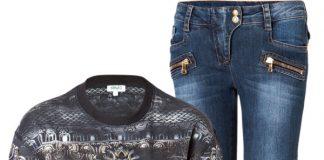 Black and gray Kenzo embroidered evil eye sweatshirt Balmain blue low rise biker jeans Giuseppe Zanotti black leather combat boots Burberry drawstring bag