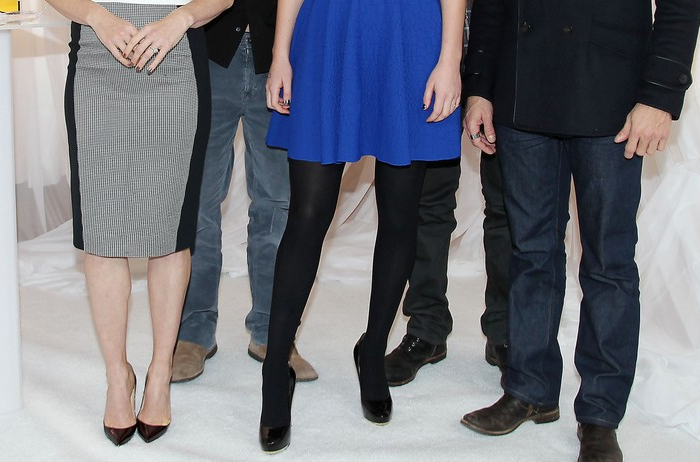 Jennifer Lawrence black tights black pumps blue Alexander McQueen dress