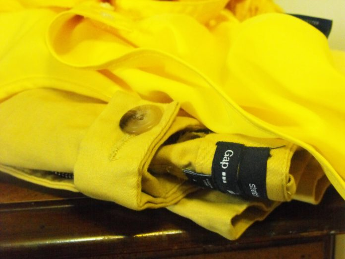 Gap yellow stretch pants folded on table