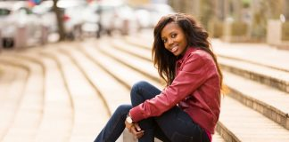 Beautiful African American woman sitting on steps