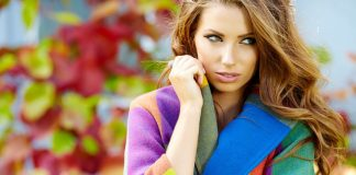 woman in colorful jacket fall autumn scene cropped