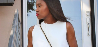 Ranti Onayemi Chanel classic flap bag gold black skirt white top outfit