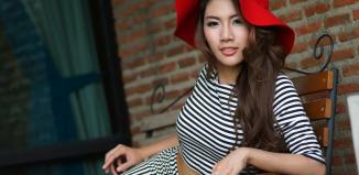 Thai model black white striped top bottom red hat 1