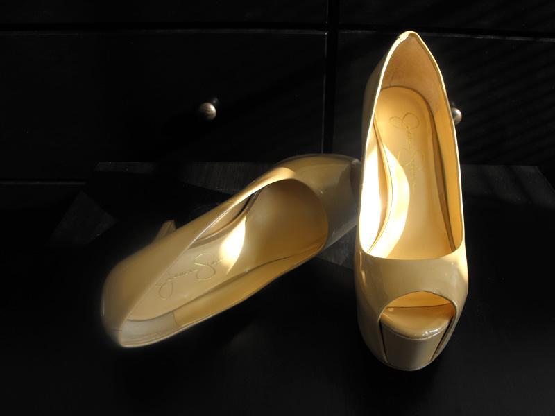 Carri patent peep toe nude Jessica Simpson pumps on black top table