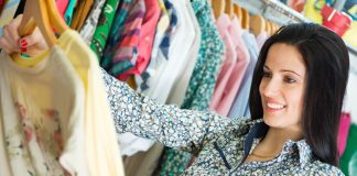 woman looking at tops in closet