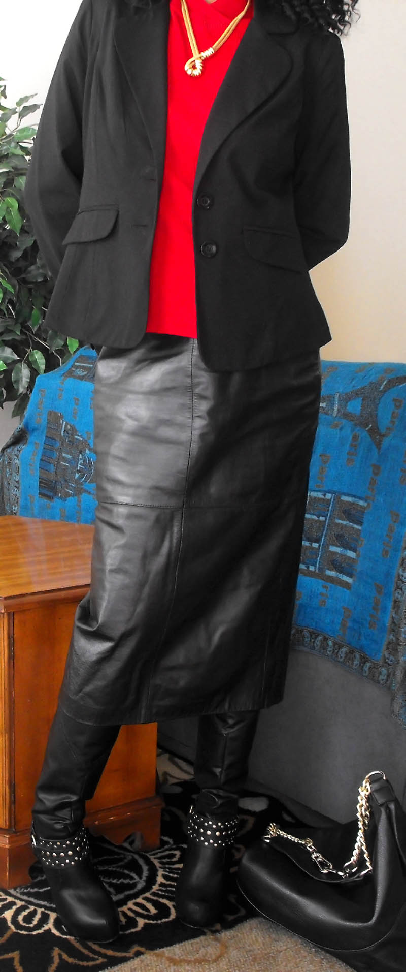 black leather skirt red top black blazer black stiletto knee high boots fake gold necklace