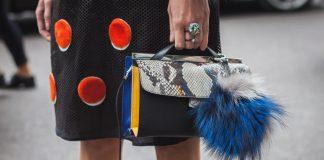 woman holding desginer handbag
