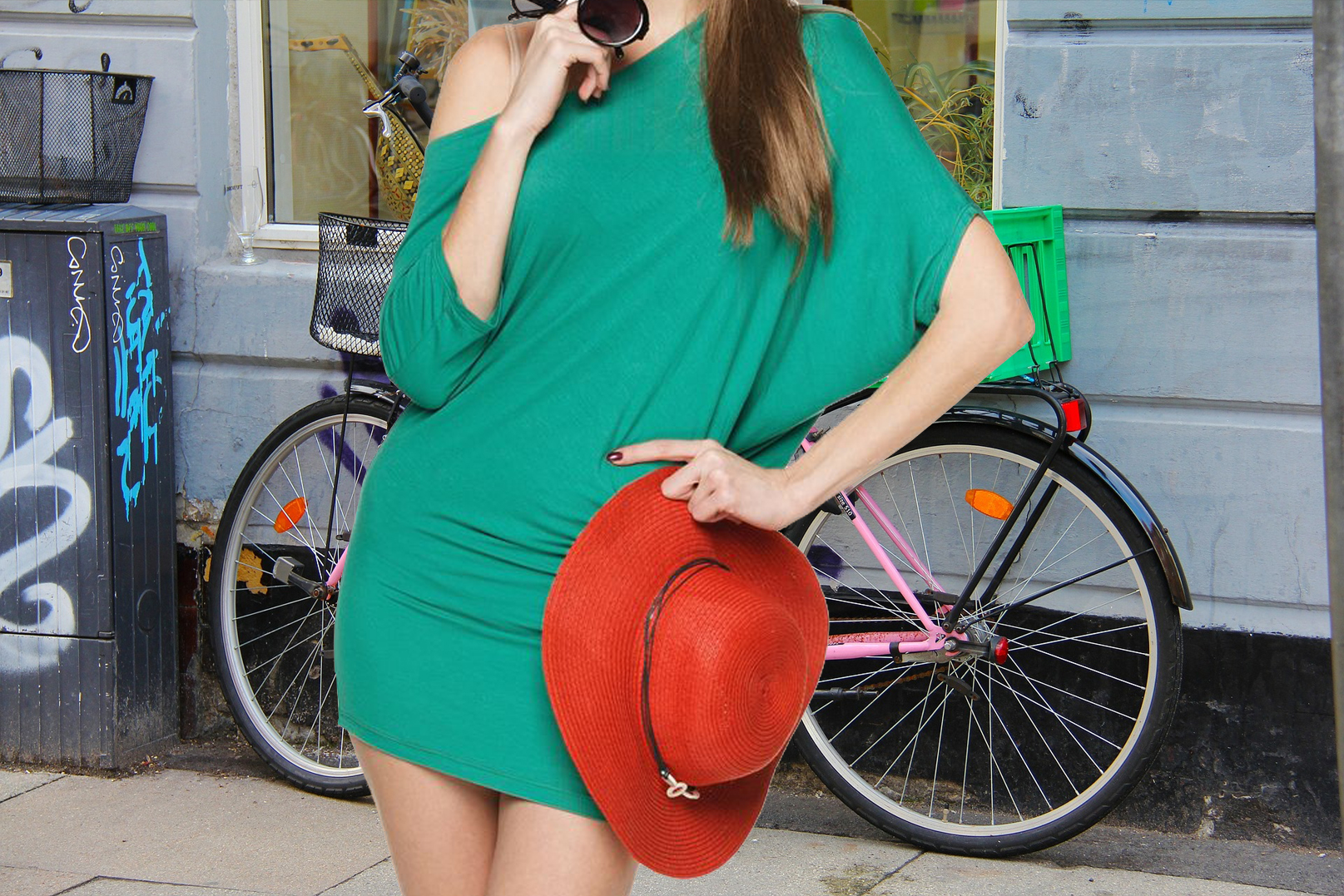 woman in green dress with red hat