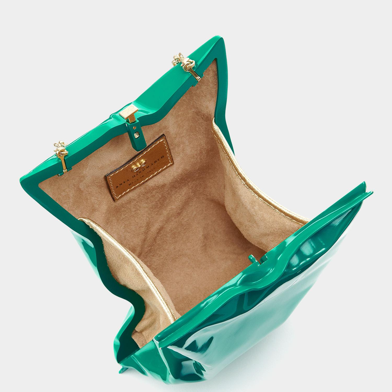 Anya Hindmarch crisp packet clutch emerald green