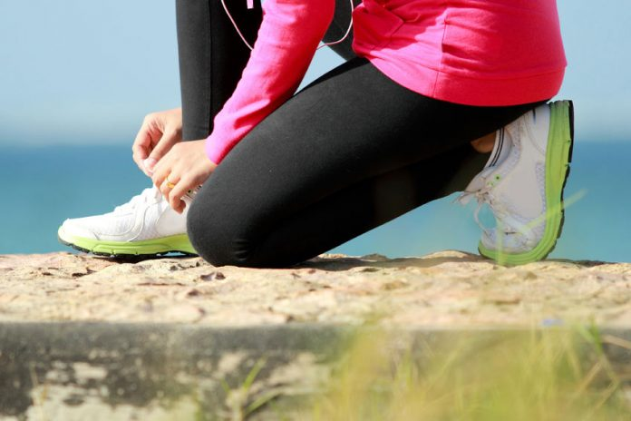 girl tying shoe laces womens cross trainers