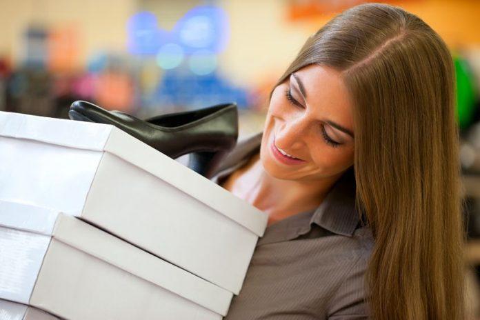 woman holding shoe boxes black pumps