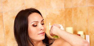 woman shaving underarms