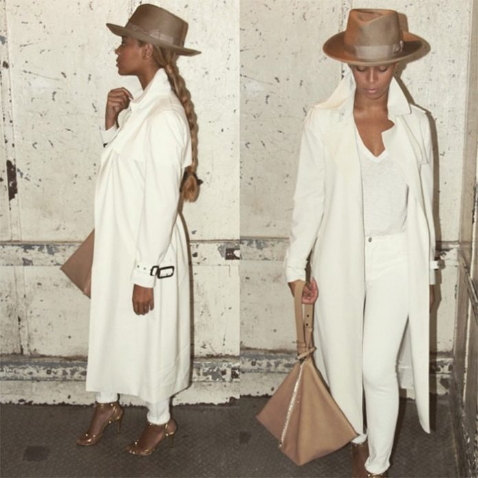Beyonce wearing white shirt with white pants white trench coat beige fedora beige bag