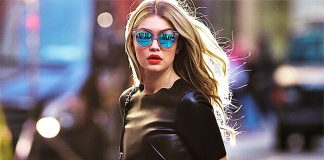 Gigi Hadid black top pink pants Maybelline