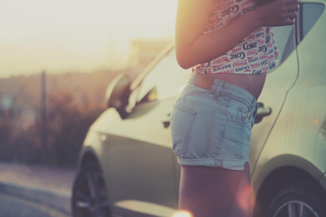 Girl wearing crop top denim shorts