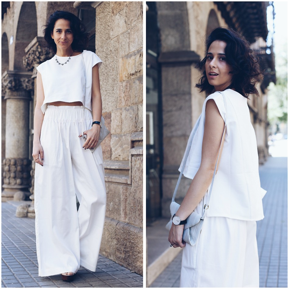 Milagros Plaza style blogger from Barcelona Spain wearing white crop top with White High Waist Palazzo Trousers