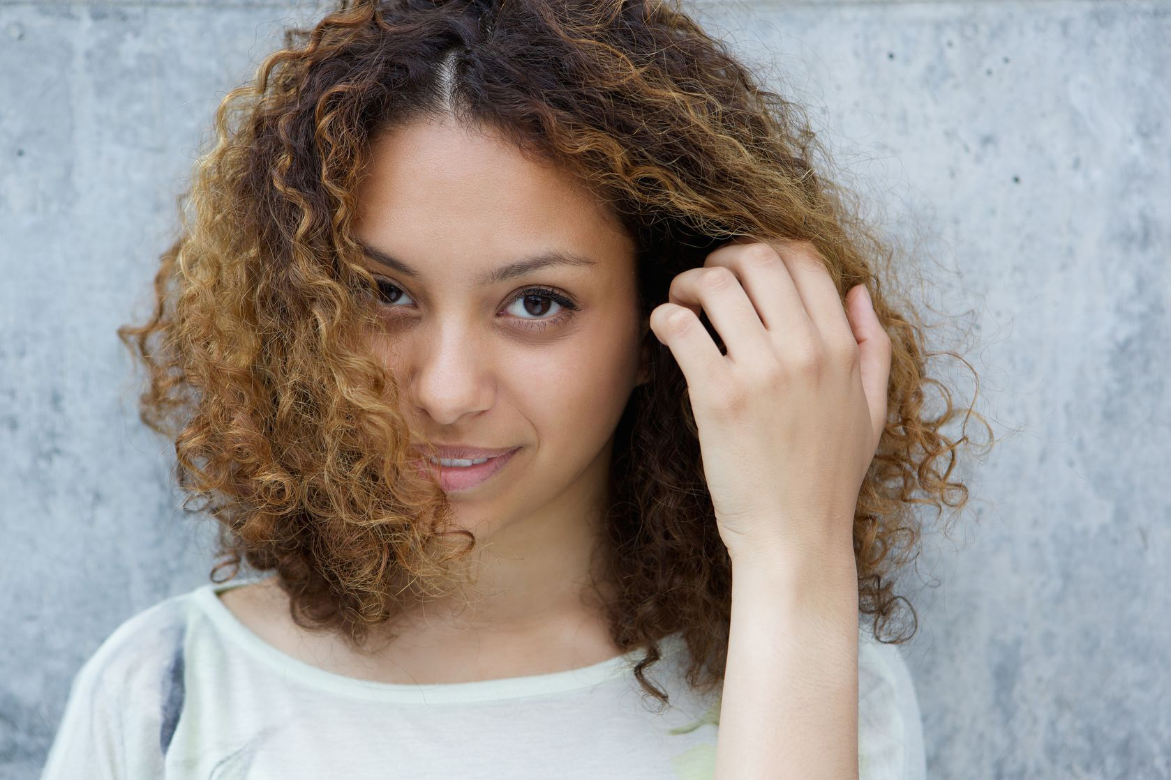 girl curly hair clear skin