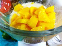 mango in coconut milk in blender