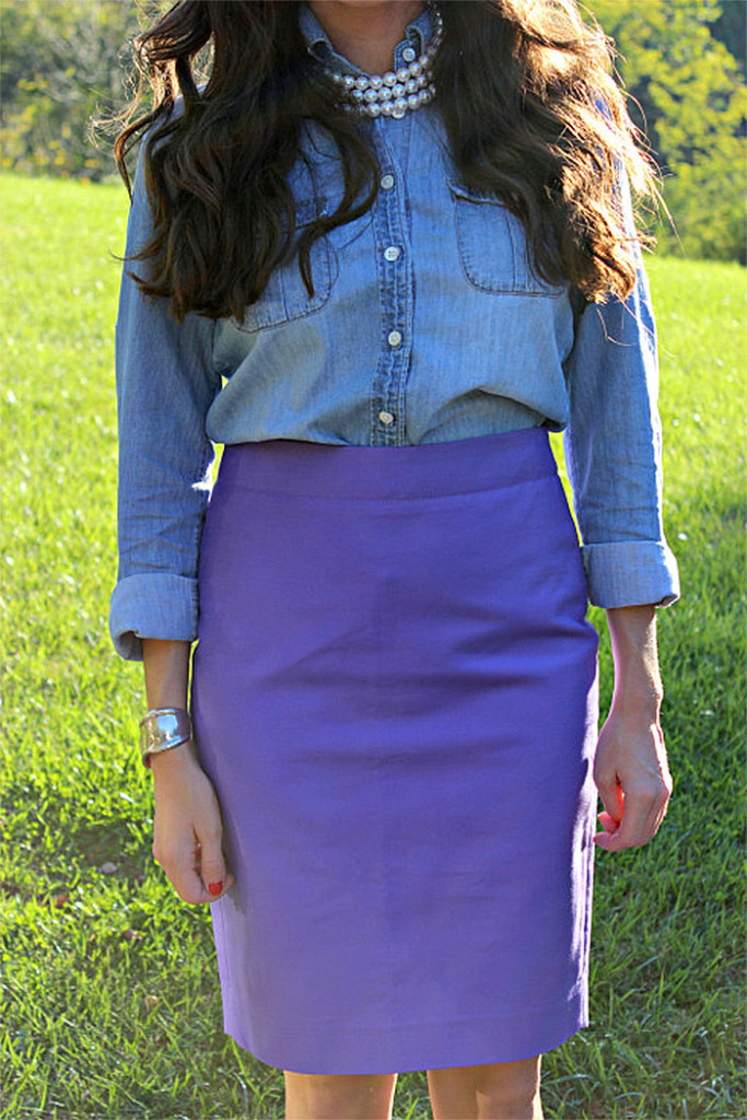 Baubles to bubbles blogger Olivia wears a blue denim shirt with a purple pencil skirt
