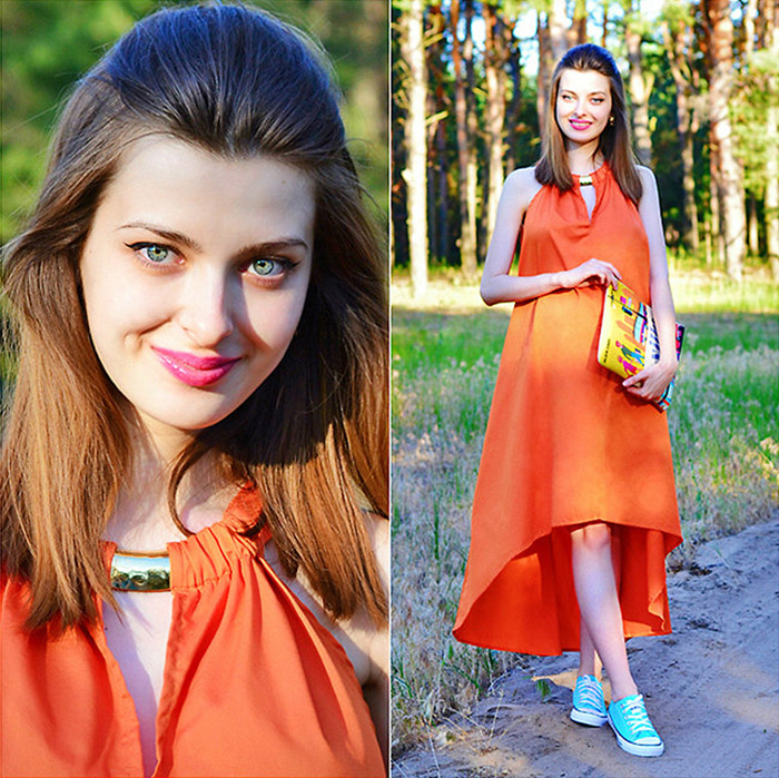 Malinina-ek from the Ukraine wearing an orange dress with turquoise blue converse sneakers