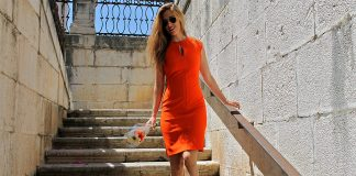 Natalia Champs from Spain wears an orange Zara bodycon dress wth beige gold Zara sandals