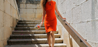 Natalia Champs from Spain wears an orange Zara bodycon dress wth beige gold Zara sandals