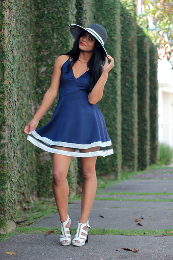 Sica Ramos from Sao Paulo Brazil wears white strappy sandals with a blue dress