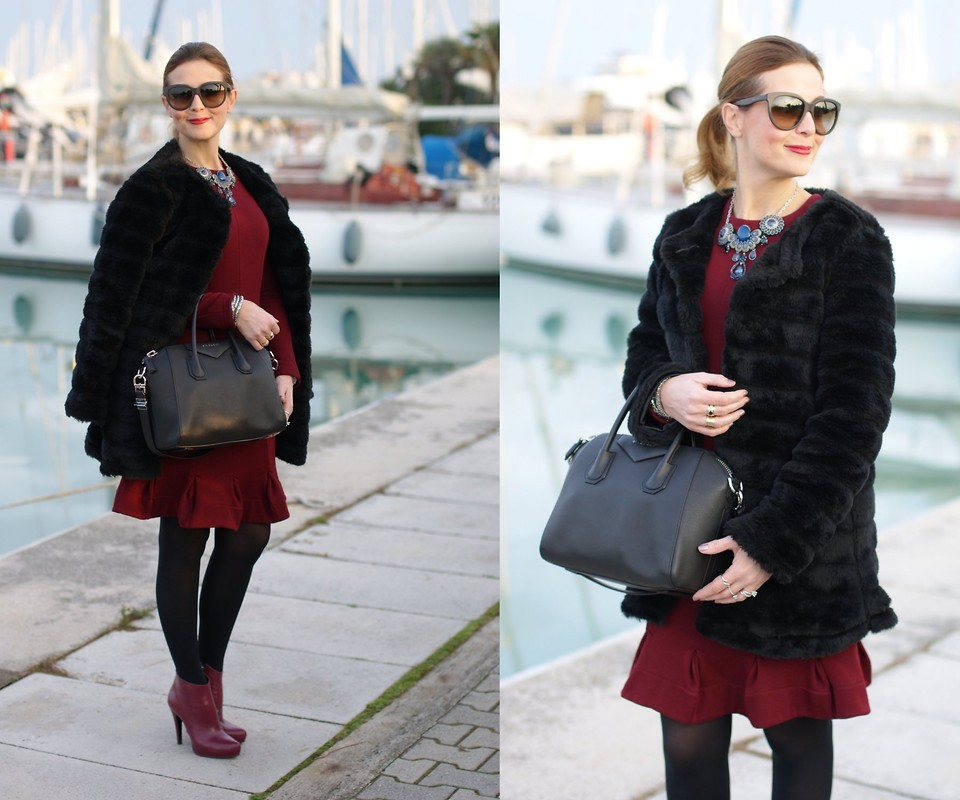 Vale from the blog Fashion and Cookies wears burgundy ankle boots with a burgundy dress