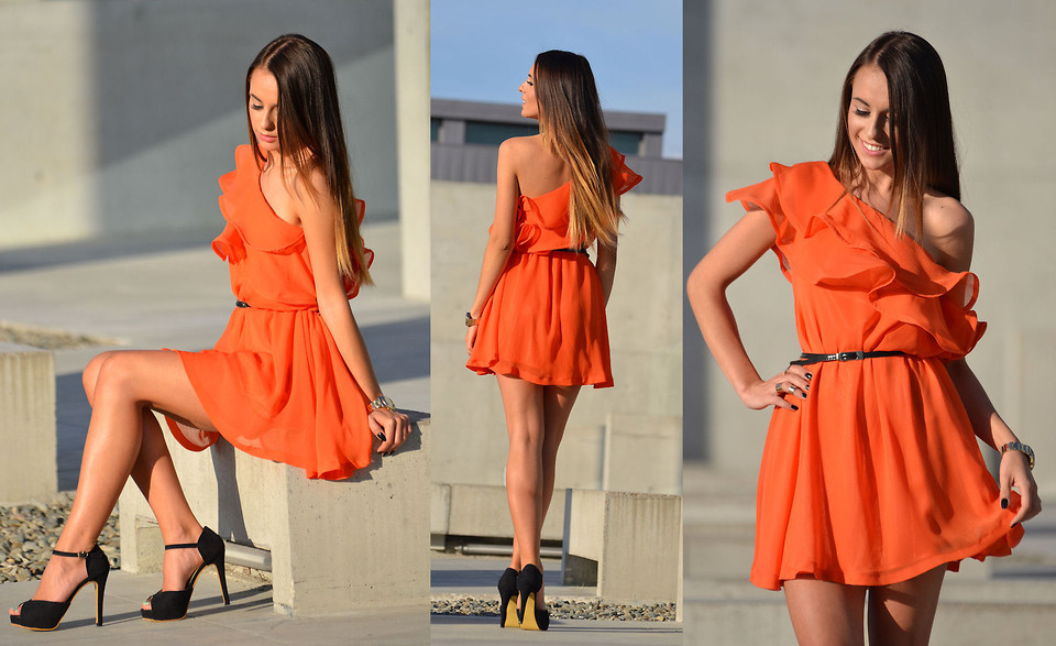 Zuza Str Poland wears black high heeled pumps with orange dress