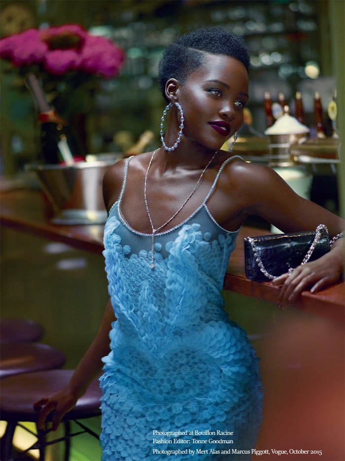 Lupita Nyongo wearing blue Givenchy by Riccardo Tisci Haute Couture lace dress photographed by Mert Alas and Marcus Piggott for Vogue October 2015