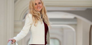 lady in burgundy dress with white jacket