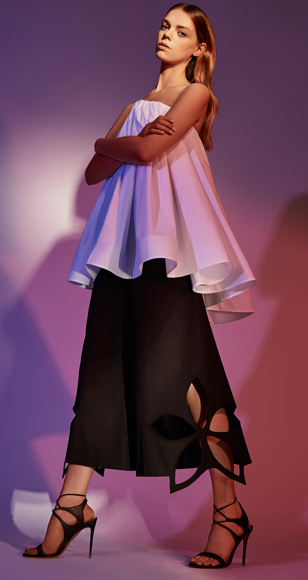 White maticevski top with black rosie assoulin flower cut-out pants