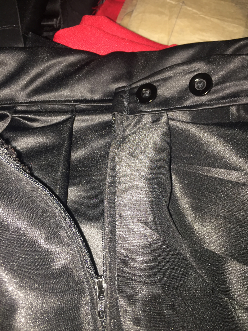 black pleated skirt zipper and button fastening