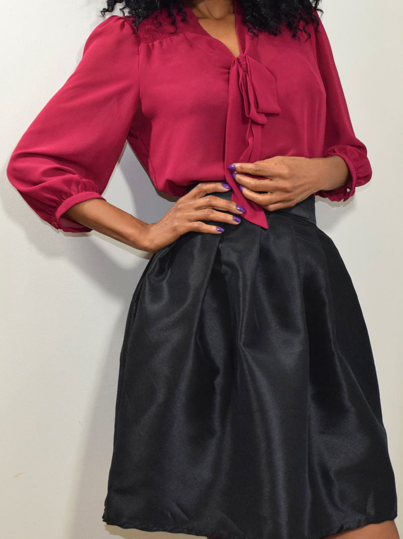 the black skirt with burgundy top
