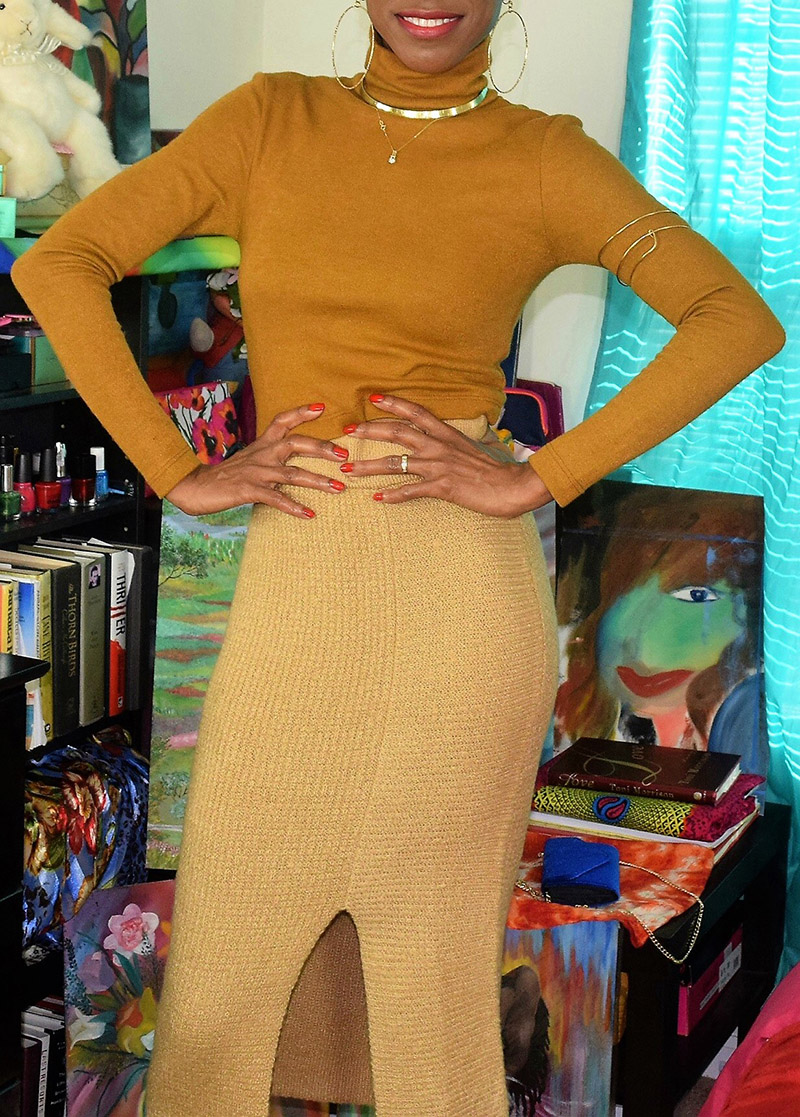 monica wearing WAYF franklin turtleneck tobacco with BP rib knit sweater skirt in tan toffee