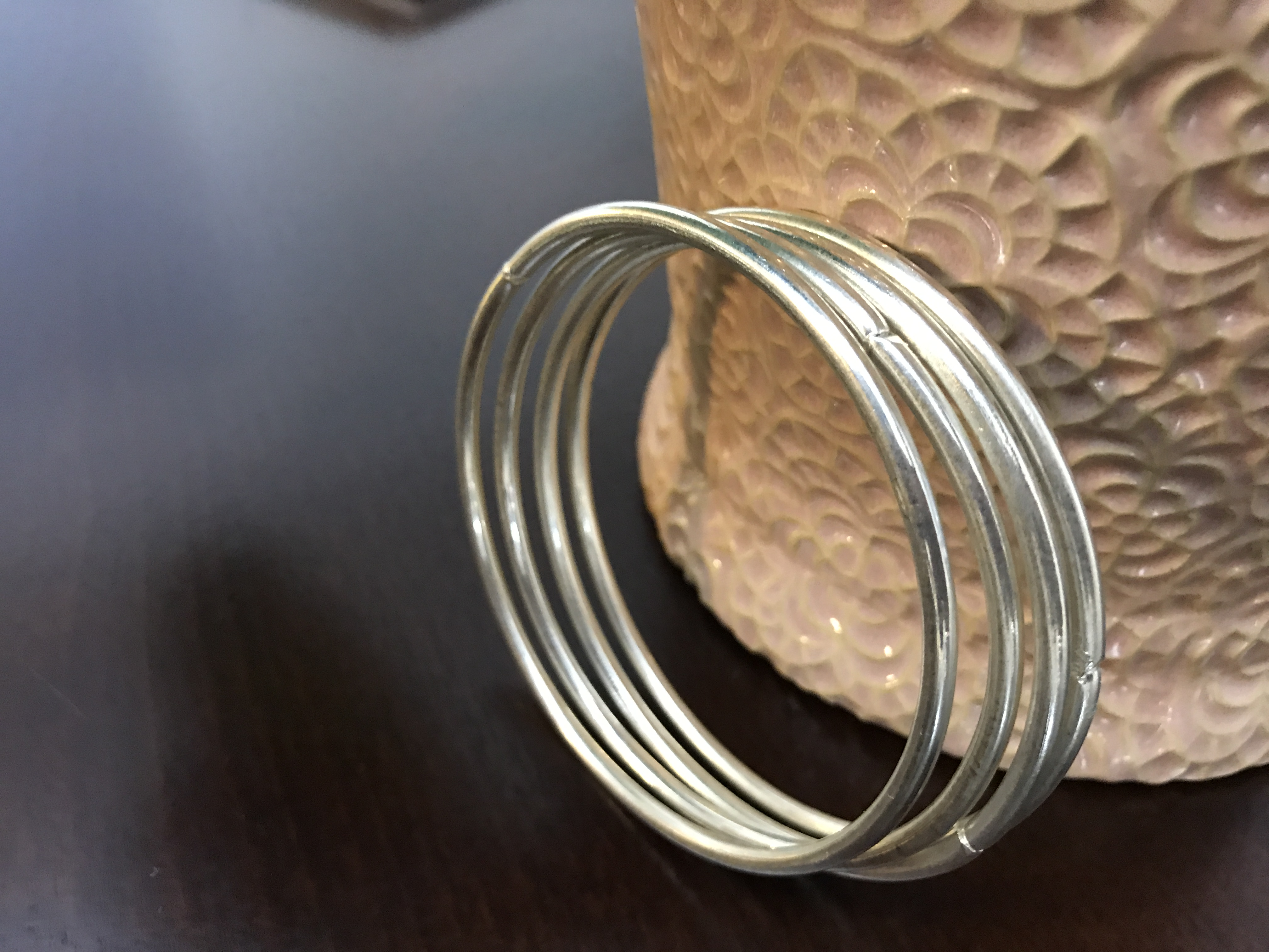 Set of 4 silver tone bangle bracelets used