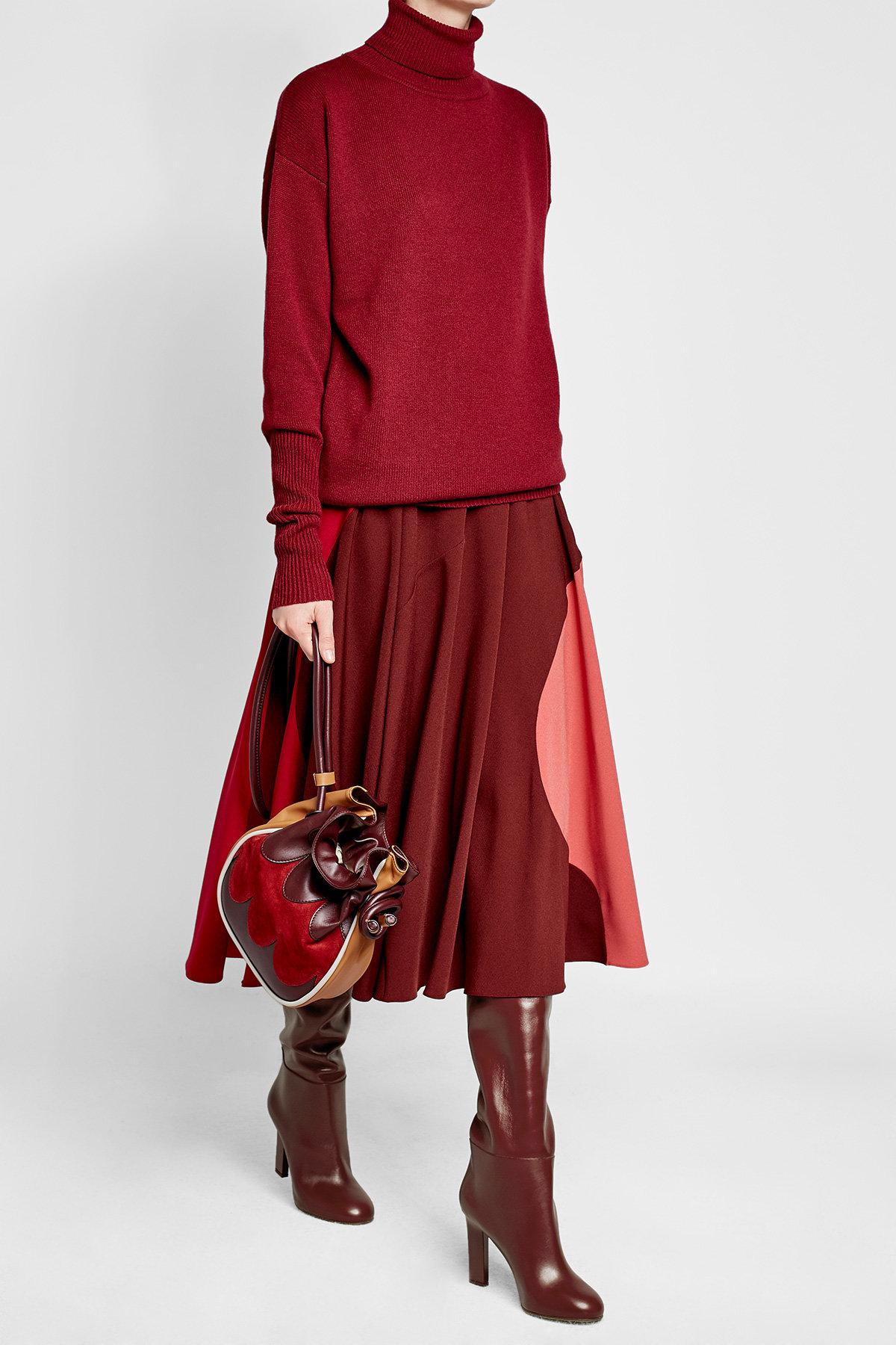 Victoria Beckham burgundy knee high boots sweater marni bag roksanda midi skirt