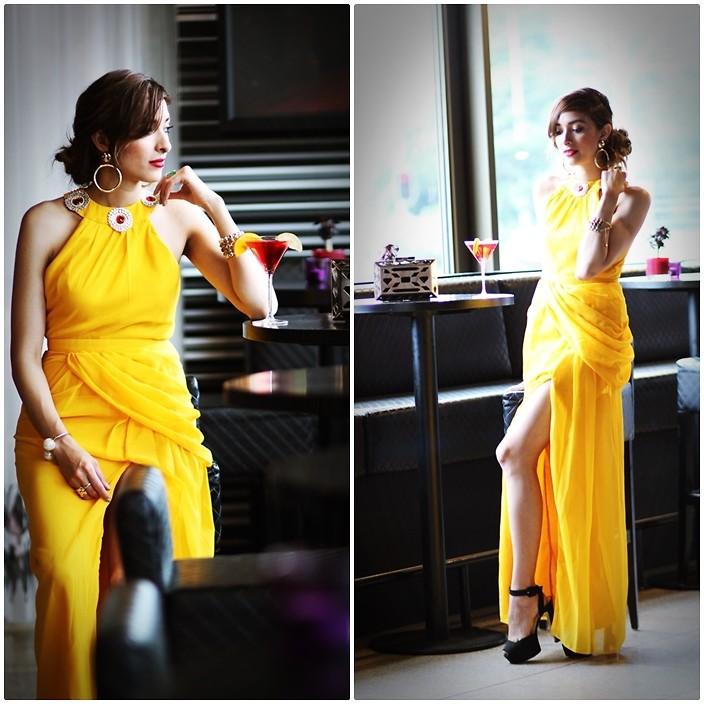 Ecuadorean Dutch Fashion Blogger Virgit Canaz from the PreppyFashionist wearing black heels with a yellow dress