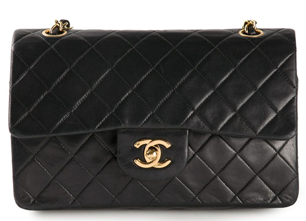 Black lambskin leather small double flap bag from Chanel Vintage