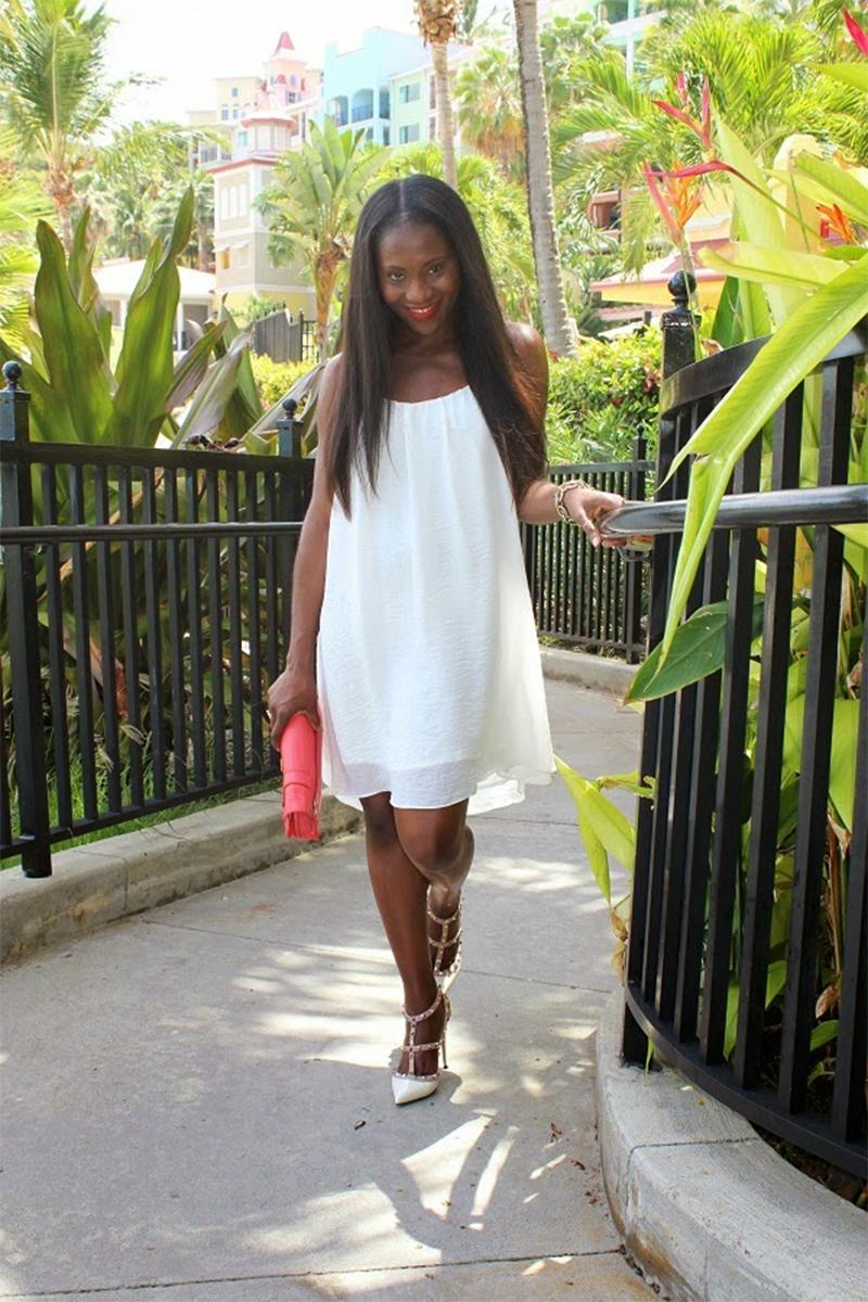 Ranti Onayemi wearing a white Just Female Swing Cami Dress with Valentino rockstud heels and proenza schouler papaya clutch