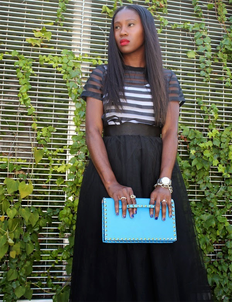 Ranti Onayemi wearing the Wendy black maxi tulle skirt with girls on Film Sheer Panel Boxy Crop Top with Valentino clutch