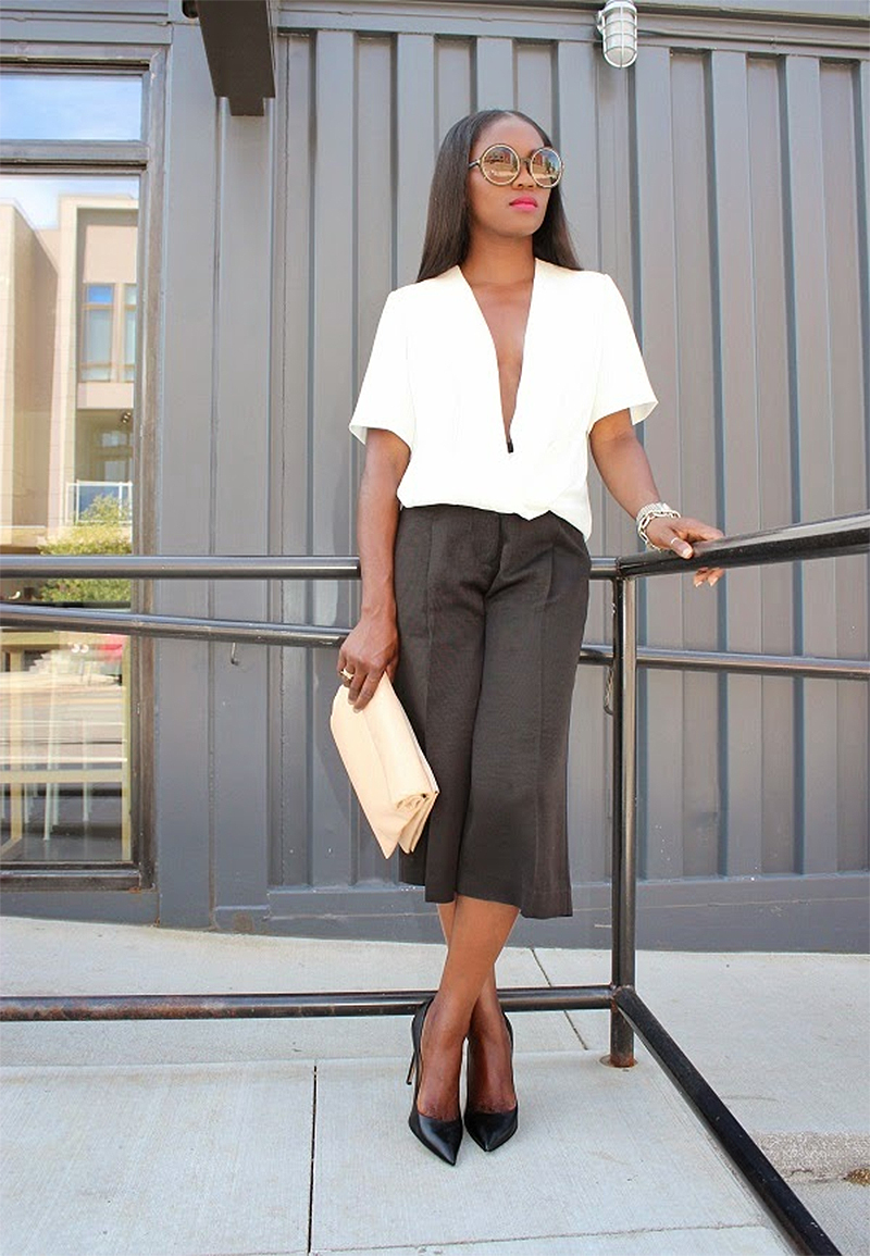 Ranti Onayemi wearing white Alexander Wang surplice top with black culottes Valentino black leather pumps Celine clutch purse