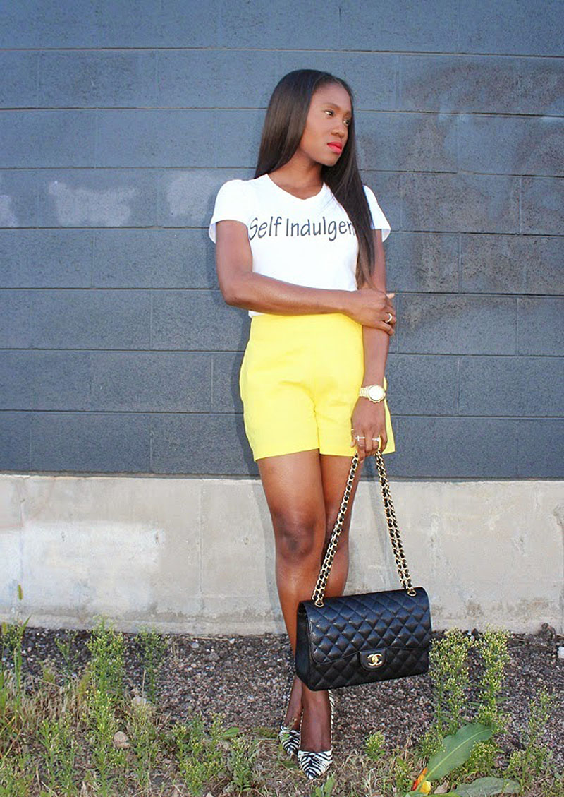 Ranti Onayemi yellow shorts self indulgence tee chanel flap bag