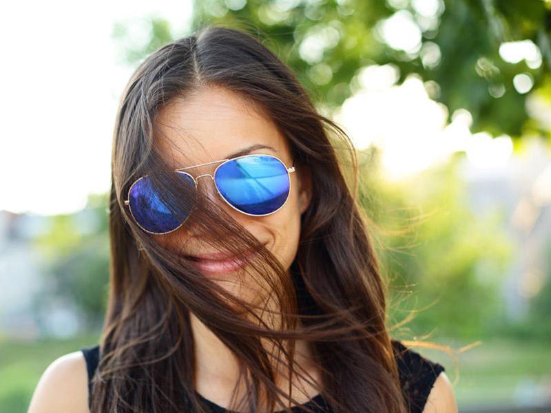girl in blue framed sunglasses