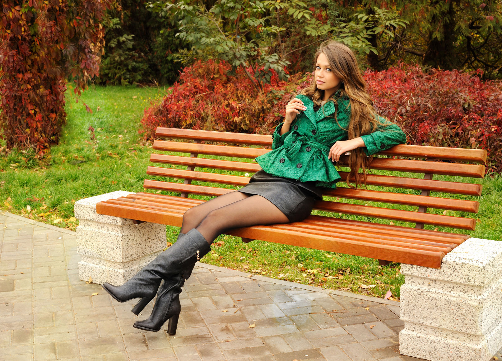 in stock outlet online elegant shoes Cute girl sitting on a bench in the park black leather knee ...