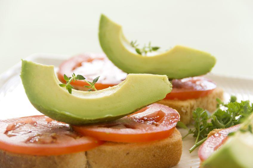 Avocado slice with tomato on toast