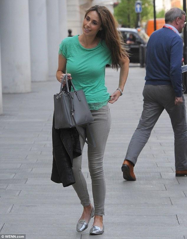 Alex Jones green top gray jeans
